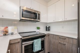 "Photo 11: 516 2525 CLARKE Street in Port Moody: Port Moody Centre Condo for sale in ""THE STRAND"" : MLS®# R2531825"