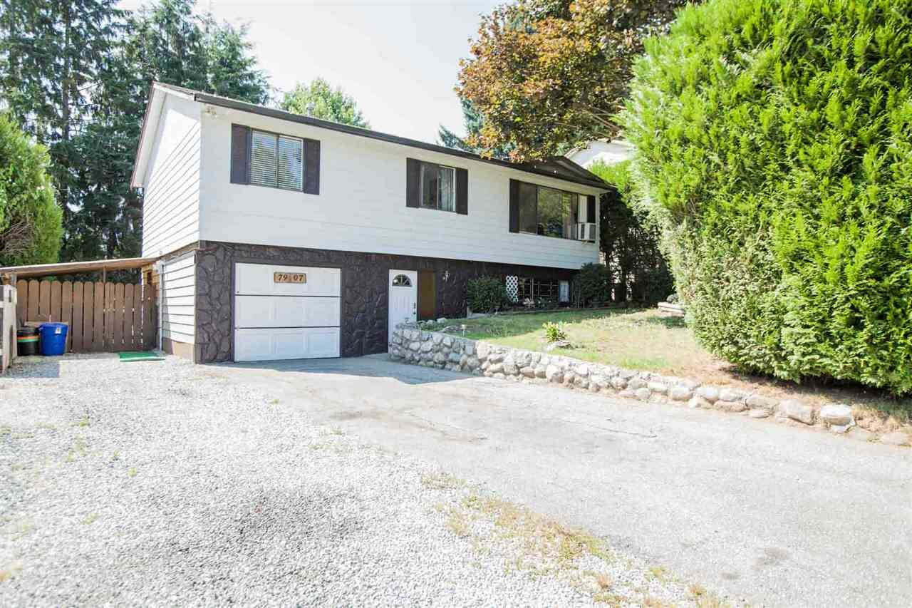 Basement entry home with a private front yard, and lots of room for extra parking