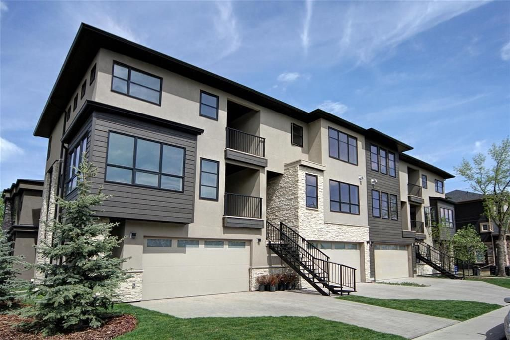 Main Photo: 3668 19 Avenue SW in Calgary: Killarney/Glengarry Row/Townhouse for sale : MLS®# C4238635