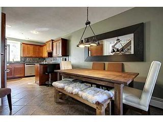 Photo 6: 6 828 COACH BLUFF Crescent SW in Calgary: 2 and Half Storey for sale : MLS®# C3560991