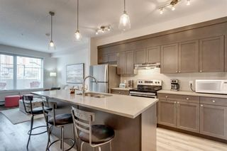 Photo 4: 104 30 Shawnee Common SW in Calgary: Shawnee Slopes Apartment for sale : MLS®# A1099308