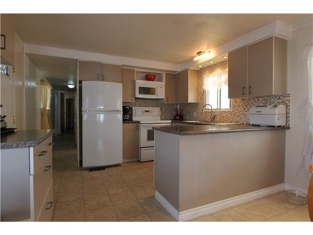 """Main Photo: 288 201 CAYER Street in Coquitlam: Maillardville Manufactured Home for sale in """"WILDWOOD PARK"""" : MLS®# V1007219"""