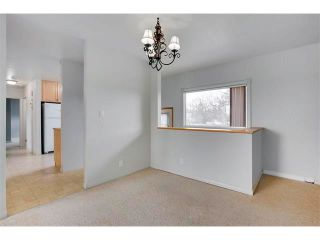 Photo 9: 3039 CANMORE Road NW in Calgary: Banff Trail House for sale