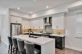 Photo 4: 1336 19 Avenue NW in Calgary: Capitol Hill Semi Detached for sale : MLS®# A1137107