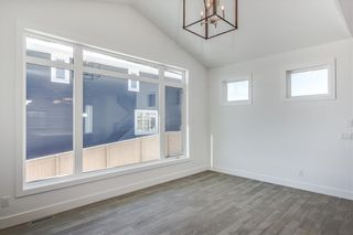 Photo 13: 152 ROCK LAKE View NW in Calgary: Rocky Ridge Detached for sale : MLS®# A1062711