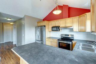 Photo 12: 402 128 Centre Avenue: Cochrane Apartment for sale : MLS®# A1129690