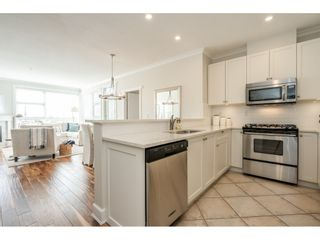"Photo 2: 103 4500 WESTWATER Drive in Richmond: Steveston South Condo for sale in ""COPPER SKY WEST"" : MLS®# R2447932"