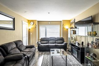 """Photo 1: 211 2373 ATKINS Avenue in Port Coquitlam: Central Pt Coquitlam Condo for sale in """"CARMANDY"""" : MLS®# R2613628"""