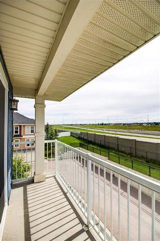 Photo 18: 50 Auburn Bay Common SE in Calgary: Auburn Bay Row/Townhouse for sale : MLS®# A1128928