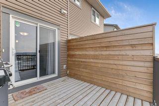 Photo 23: 333 Heartland Crescent: Cochrane Semi Detached for sale : MLS®# A1063240