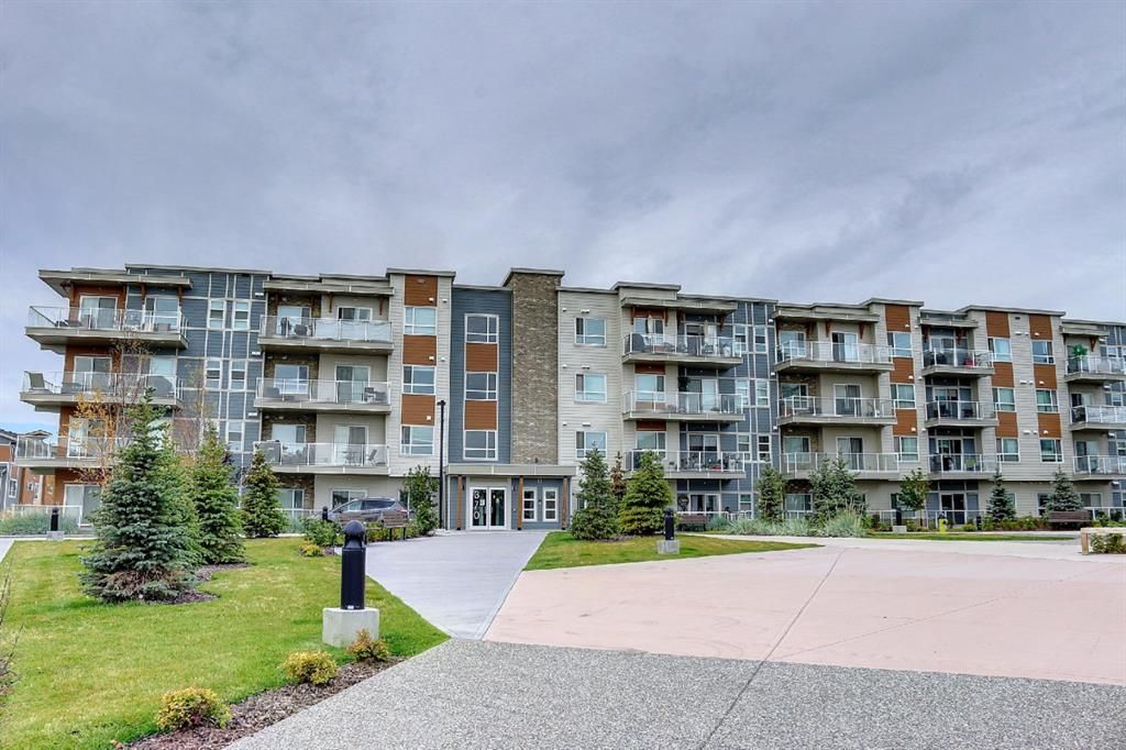 Main Photo: 210 370 Harvest Hills Common NE in Calgary: Harvest Hills Apartment for sale : MLS®# A1150315