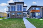 Main Photo: 213 18 Street NW in Calgary: West Hillhurst Semi Detached for sale : MLS®# A1029385