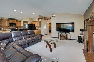 Photo 7: 230 AUBURN BAY Cove SE in Calgary: Auburn Bay Detached for sale : MLS®# A1096112