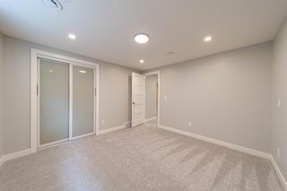 Photo 32: 944 Parkvalley Way SE in Calgary: Parkland Detached for sale : MLS®# A1153564