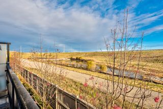 Photo 8: 504 Panatella Walk NW in Calgary: Panorama Hills Row/Townhouse for sale : MLS®# A1153133