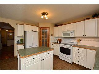 Photo 10: 108 GLENEAGLES Terrace: Cochrane House for sale : MLS®# C4113548
