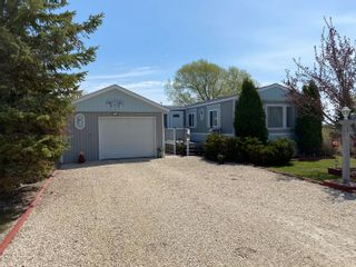 Photo 1: 16 King Crescent in Portage la Prairie RM: House for sale : MLS®# 202112003