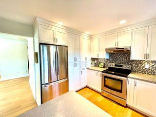 "Photo 15: 1 12969 17 Avenue in Surrey: Crescent Bch Ocean Pk. Townhouse for sale in ""OCEAN PARK GROVE"" (South Surrey White Rock)  : MLS®# R2621142"