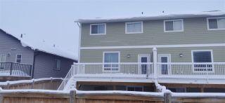 "Photo 2: 11109 104A Avenue in Fort St. John: Fort St. John - City NW 1/2 Duplex for sale in ""SUNSET RIDGE"" (Fort St. John (Zone 60))  : MLS®# R2519359"