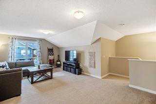 Photo 19: 1204 10 AUBURN BAY Avenue SE in Calgary: Auburn Bay Row/Townhouse for sale : MLS®# A1065411