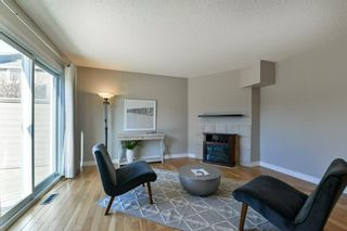 Photo 9: 1301 829 Coach Bluff Crescent in Calgary: Coach Hill Row/Townhouse for sale : MLS®# A1094909