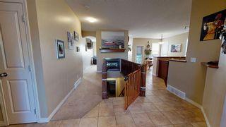 Photo 10: 708 Boulder Creek Drive SE: Langdon Detached for sale : MLS®# A1153144
