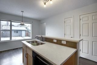 Photo 12: 157 Eversyde Boulevard SW in Calgary: Evergreen Semi Detached for sale : MLS®# A1055138