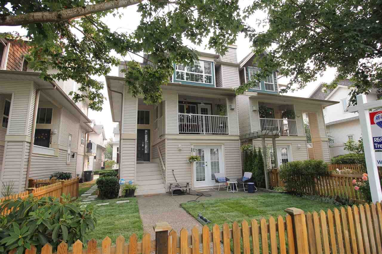 """Main Photo: 18610 65 Avenue in Surrey: Cloverdale BC Townhouse for sale in """"Ridgeway"""" (Cloverdale)  : MLS®# R2299055"""