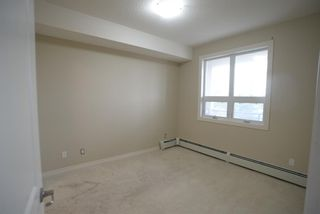 Photo 10: 204 26 VAL GARDENA View SW in Calgary: Springbank Hill Apartment for sale : MLS®# A1045498