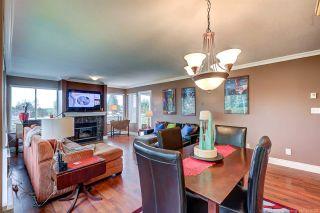 "Photo 7: 210 9310 KING GEORGE Boulevard in Surrey: Bear Creek Green Timbers Townhouse for sale in ""HUNTSFIRLED"" : MLS®# R2507039"
