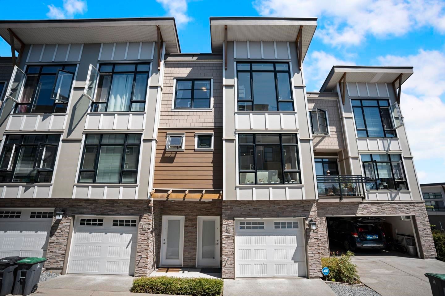 """Main Photo: 67 9989 BARNSTON Drive in Surrey: Fraser Heights Townhouse for sale in """"Highcrest"""" (North Surrey)  : MLS®# R2606291"""