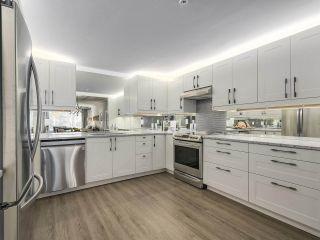 Photo 10: 209 1150 54A Street in Delta: Tsawwassen Central Condo for sale (Tsawwassen)  : MLS®# R2243733