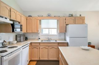 """Photo 10: 109 19649 53 Avenue in Langley: Langley City Townhouse for sale in """"Huntsfield Green"""" : MLS®# R2591188"""