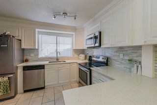 "Photo 3: 857 OLD LILLOOET Road in North Vancouver: Lynnmour Townhouse for sale in ""LYNNMOUR VILLAGE"" : MLS®# R2337354"