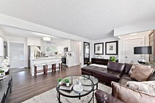 Photo 4: 805 67 Avenue SW in Calgary: Kingsland Detached for sale : MLS®# A1115484