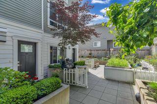 "Photo 1: 10 638 REGAN Avenue in Coquitlam: Coquitlam West Townhouse for sale in ""NEST"" : MLS®# R2594599"
