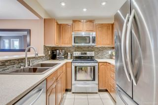 """Photo 2: 201 6707 SOUTHPOINT Drive in Burnaby: South Slope Condo for sale in """"MISSION WOODS"""" (Burnaby South)  : MLS®# R2037304"""