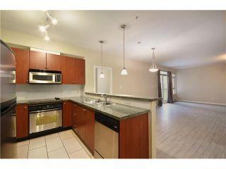 Photo 2: 315 100 CAPILANO Road in Port Moody: Port Moody Centre Condo for sale : MLS®# V985603