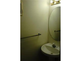 Photo 9: 208 TARINGTON Close NE in Calgary: Taradale House for sale : MLS®# C4040082