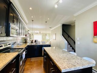 "Photo 10: 79 6383 140 Street in Surrey: Sullivan Station Townhouse for sale in ""PANORAMA WEST VILLAGE"" : MLS®# R2543747"
