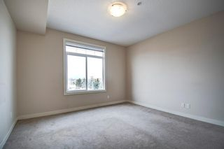 Photo 25: 304 132 1 Avenue NW: Airdrie Apartment for sale : MLS®# A1091993