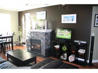 """Photo 2: # 410 3625 WINDCREST DR in North Vancouver: Roche Point Condo for sale in """"WINDSONG 111 @ RAVEN WOODS"""" : MLS®# V930131"""