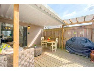 "Photo 7: 125 2721 ATLIN Place in Coquitlam: Coquitlam East Townhouse for sale in ""THE TERRACES"" : MLS®# V1057013"