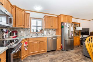 """Photo 13: 113 6338 VEDDER Road in Chilliwack: Sardis East Vedder Rd Manufactured Home for sale in """"MAPLE MEADOWS"""" (Sardis)  : MLS®# R2604784"""