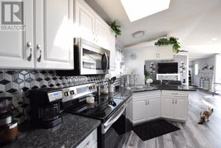 Photo 4: 9 Meadowplace Green in Brooks: House for sale : MLS®# A1145221
