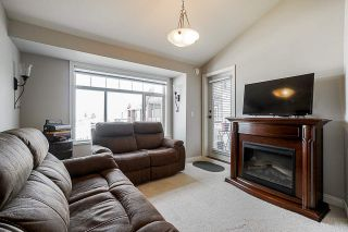 """Photo 5: 453 5660 201A Street in Langley: Langley City Condo for sale in """"Paddington Station"""" : MLS®# R2356475"""