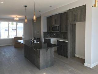 Photo 11: 23 Sunrise Heights: Cochrane Duplex for sale : MLS®# A1017998