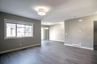 Photo 9: 555 Redstone View NE in Calgary: Redstone Row/Townhouse for sale : MLS®# A1149779