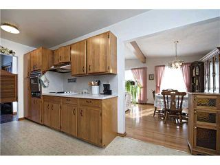 Photo 6: 3112 LANCASTER Way SW in Calgary: Lakeview House for sale : MLS®# C3654230