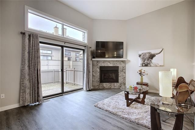 Main Photo: 18 23 GLAMIS Drive SW in Calgary: Glamorgan Row/Townhouse for sale : MLS®# C4293162
